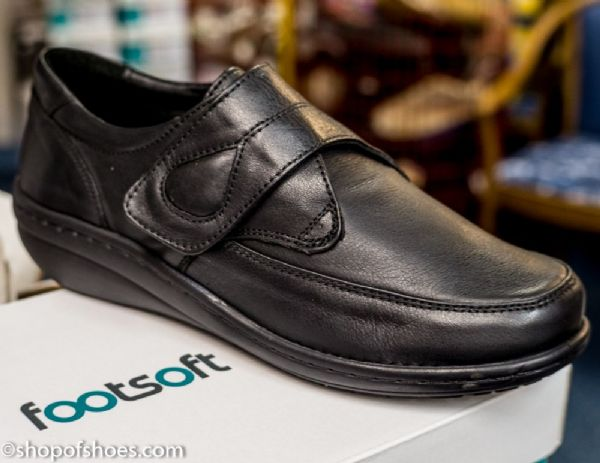 An extra soft and extra wide velcro deep black leather shoe
